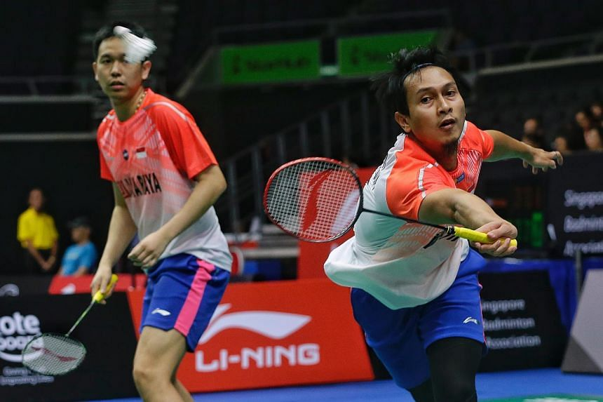 Indonesia's Mohammad Ahsan (right) and Hendra Setiawan in action against Thailand's Tinn Isriyanet and Kittisak Namdash during the Singapore Badminton Open men's doubles quarter-finals at Singapore Indoor Stadium on July 20, 2018.