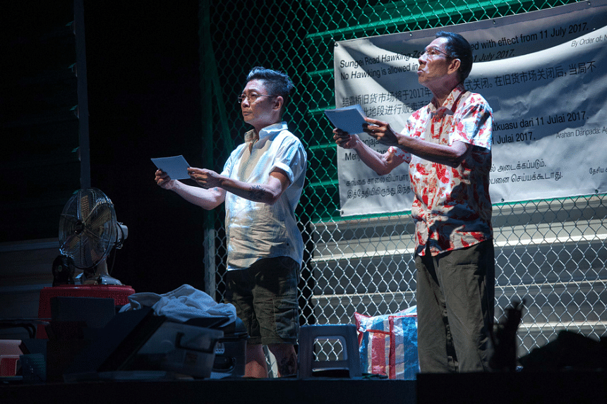 Actors Ong Kian Sin (left), and Yong Ser Pin in the theatre production One Metre Square: Voices From Sungei Road, which was performed at The Singapore Airlines Theatre at Lasalle College of the Arts.
