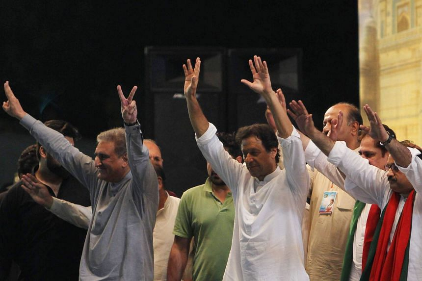 Pakistani cricket star-turned-politician and head of the party Pakistan Tehreek-e-Insaf Imran Khan (in white) at a political rally, on July 20, 2018. Historically apathetic, his young Pakistani supporters emerged as a surprise political force in the