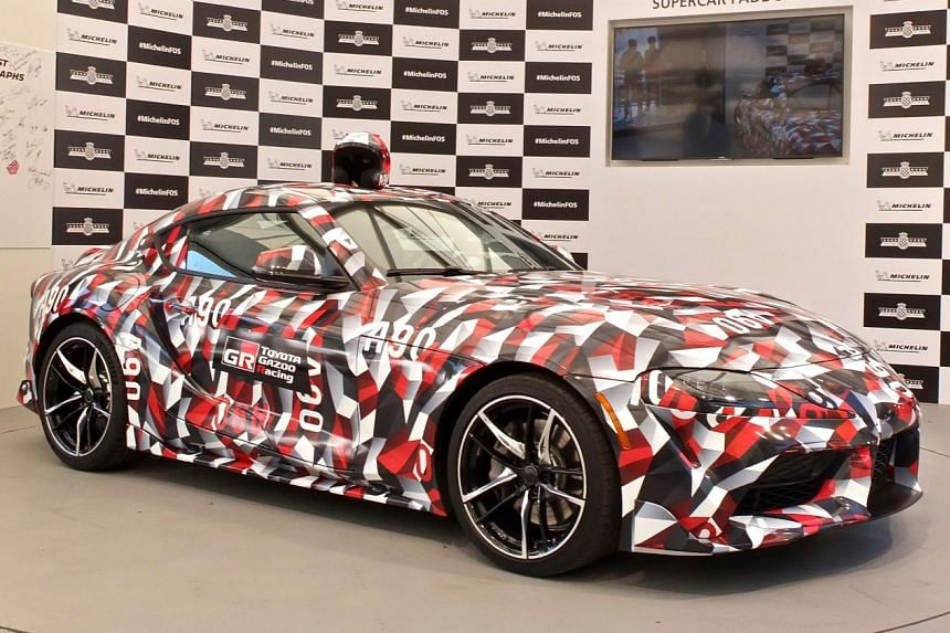 The Toyota Supra prototype (above) was camouflaged in Toyota Gazoo Racing black-red-and-white livery.