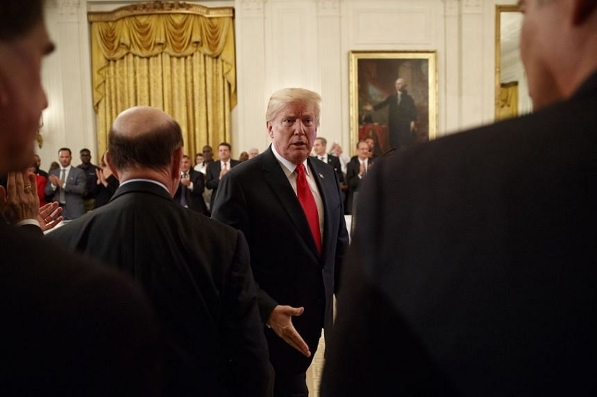 Trump greeting guests during an event at the White House on July 19, 2018.