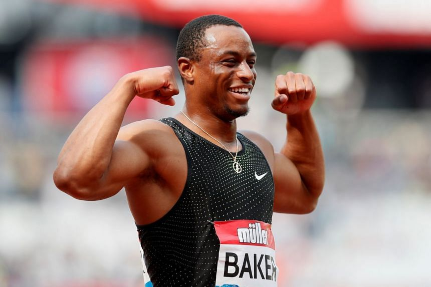 Ronnie Baker of the U.S. celebrates after winning the men's 100m final.