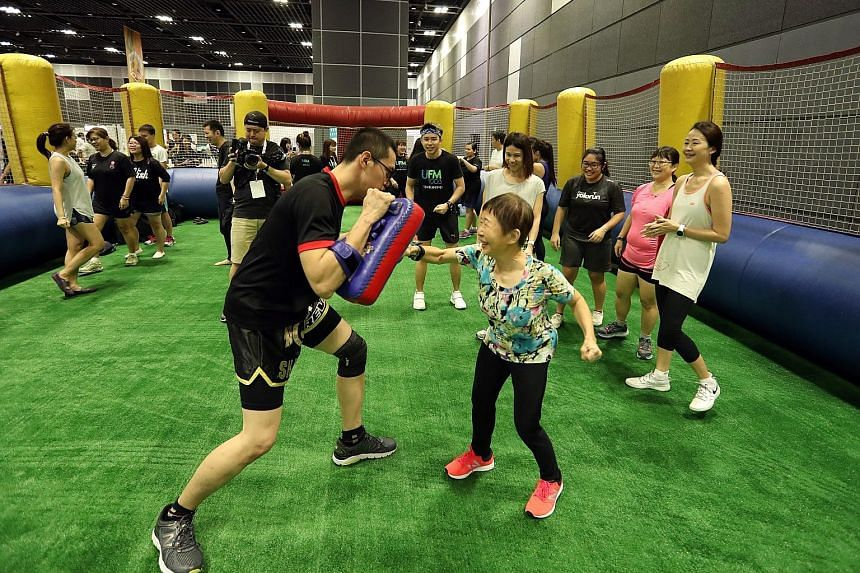 Participants at a free muay thai class during Feel Fab Fest 2018 yesterday. Organised by Singapore Press Holdings, the festival offers activities and discussions that promote a healthy lifestyle.