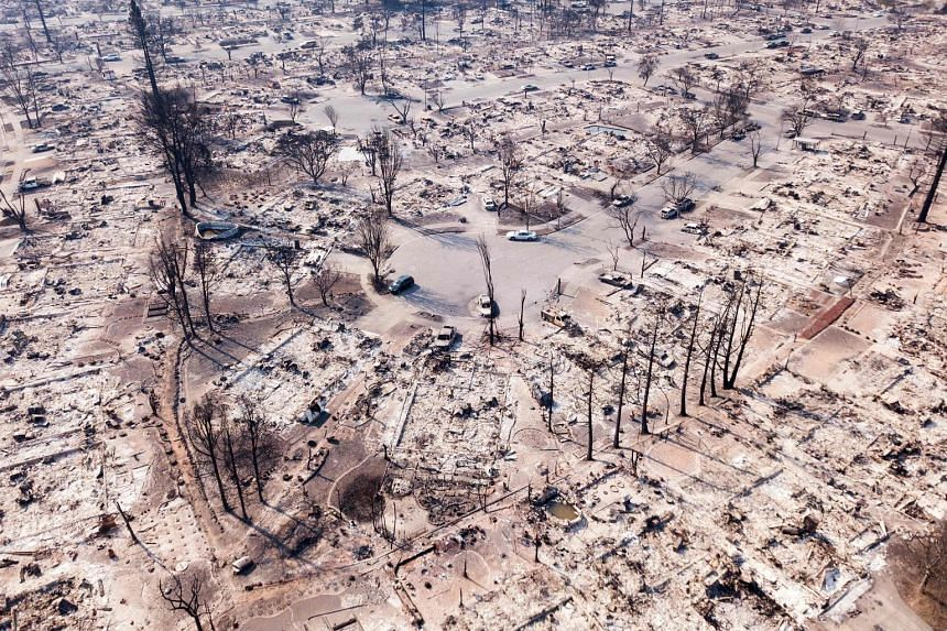 Fire damage seen from the air in Santa Rosa, California, last October. Anyone who pays much attention to climate change knows the outlook is grim, says the writer.