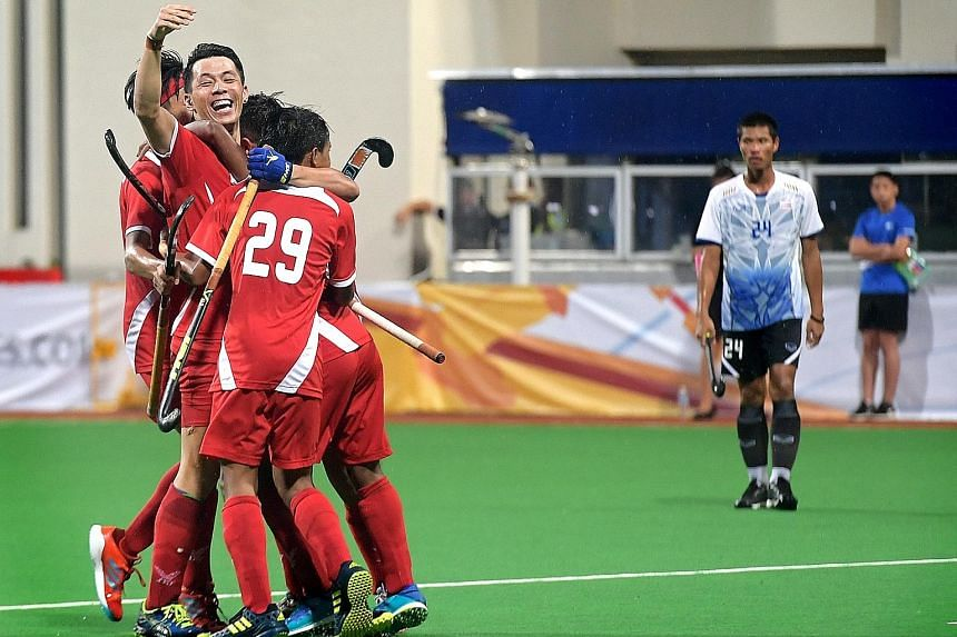 Left: The national men's hockey team celebrating their win at the Hockey Series Open earlier this month. From top: Only swimmers Joseph Schooling and Quah Zheng Wen, and sailor Maximilian Soh were granted long-term deferments over the last 15 years.