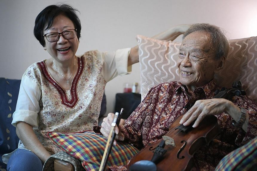 Mr Julai Tan at home with his wife, Madam Ng Siew Lan. Madam Ng, who jokes that her husband loves his violin more than her, is looking forward to his performance. Mr Tan will be performing a Bach piece, Air On The G String, and will be accompanied on