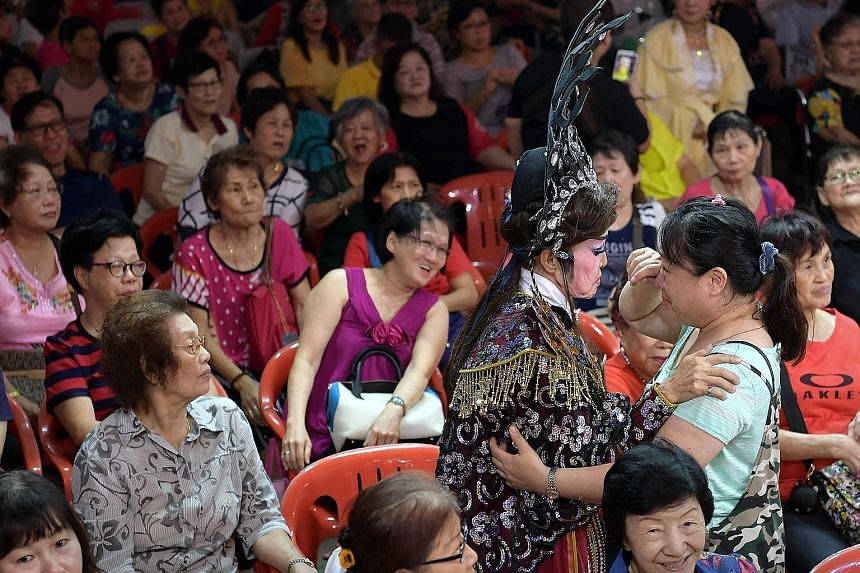 Xiao Kee Lin troupe leader Xio Kim Kee going into the crowd to thank the fans at its final performance last night.