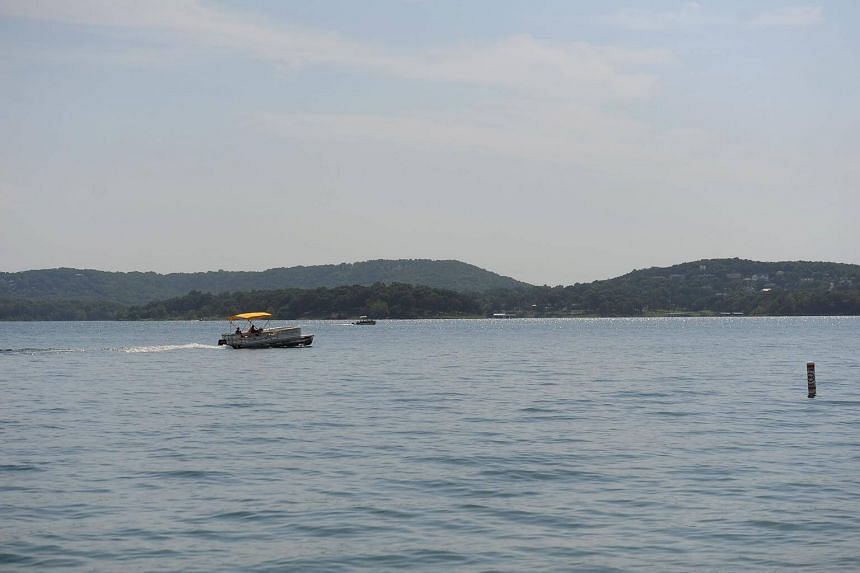 "An amphibious duck boat was carrying 31 passengers including children when a sudden ""microburst"" storm packing powerful winds hit Table Rock Lake outside Branson, unleashing white-cap waves that swamped the vessel before it sank."