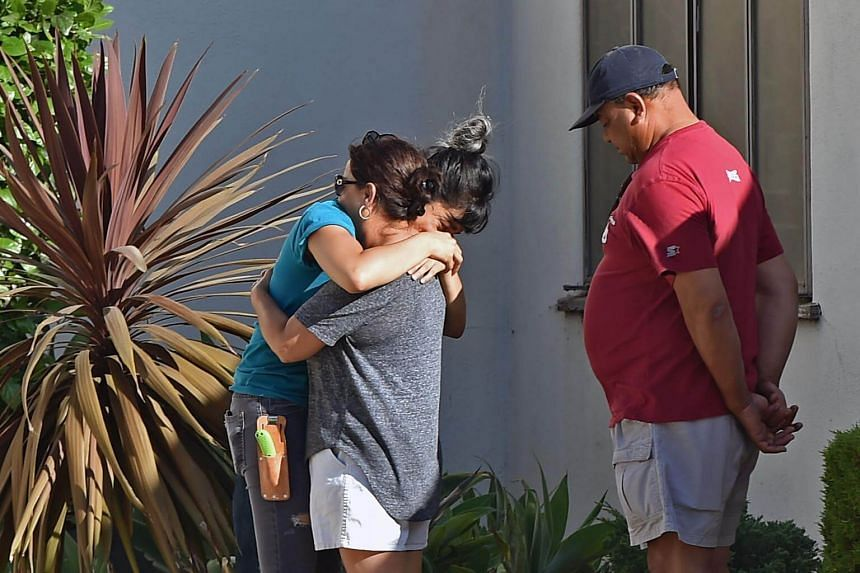 A Trader Joe's employee being comforted after a suspect was barricaded inside the supermarket in what was a possible hostage situation in Silverlake, Los Angeles, on July 21, 2018.