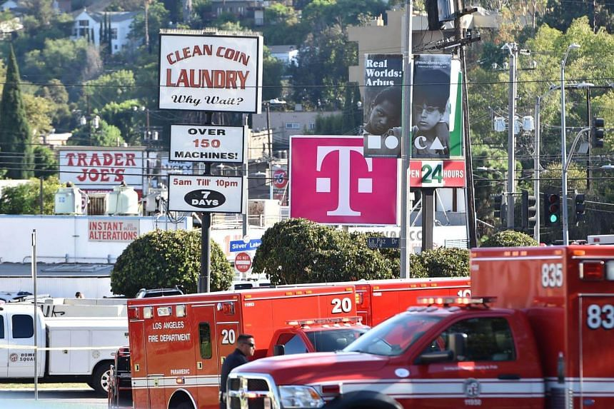 Police officers and members of the Los Angeles Fire Department are seen after a suspect was barricaded inside a Trader Joe's in Silverlake, Los Angeles, on July 21, 2018.