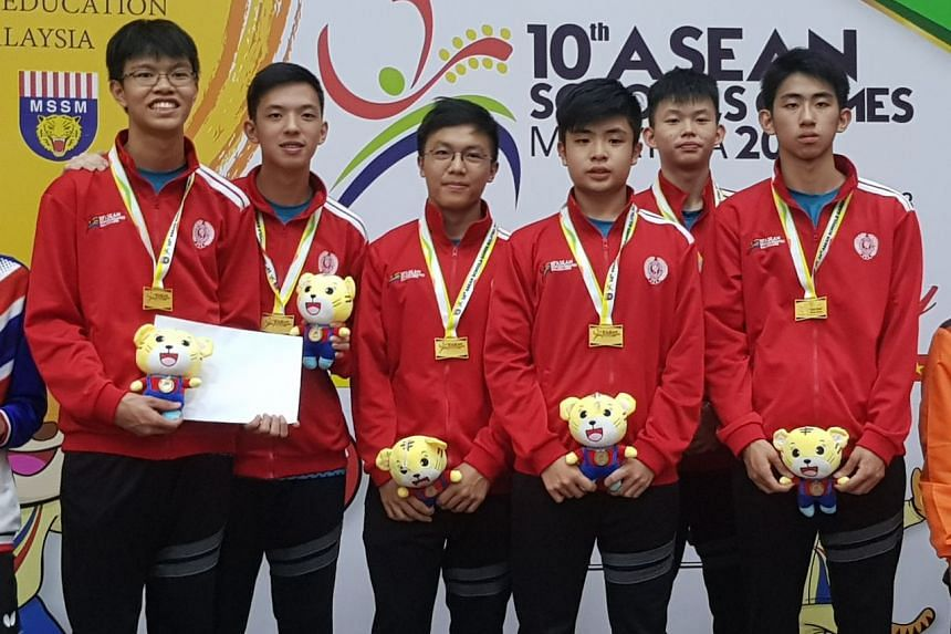 Singapore's boys table tennis team, consisting of (from left) Josh Chua, Shawn Chua, Sean Ang, Lim Dao Yi, Dominic Koh and Koen Pang, won gold at the Asean Schools Games on July 22, 2018.