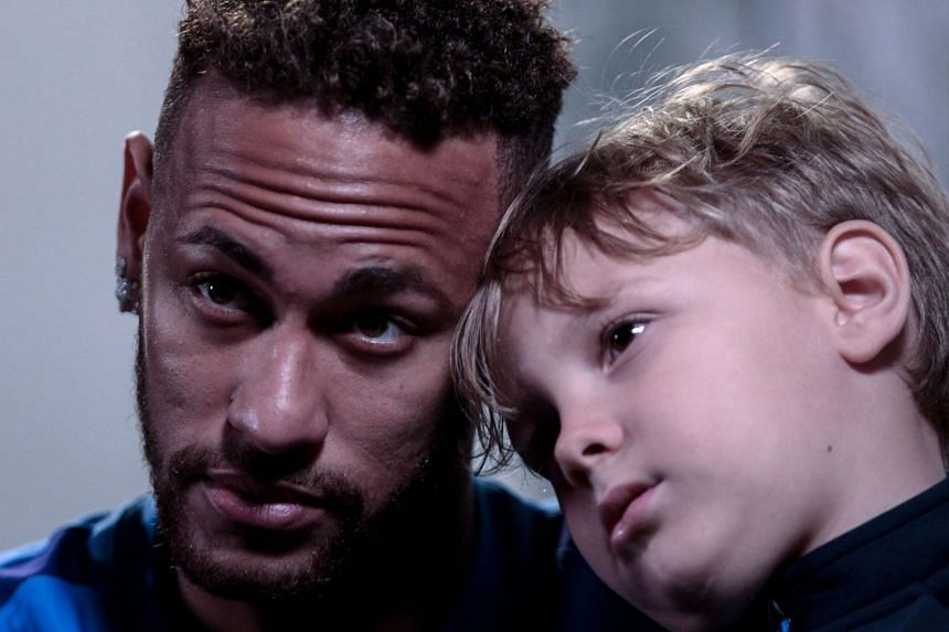 Neymar with his son Davi Lucca.
