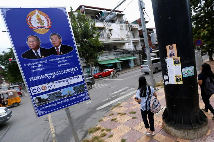 Election posters for the Cambodian People's Party (CPP) and FUNCINPEC Party are seen in Phnom Penh on July 17, 2018.