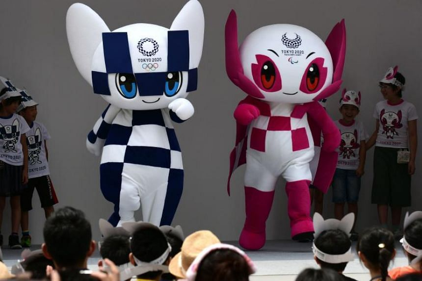 Tokyo Olympic mascots Miraitowa (left) and Someity being introduced at their debut event in Tokyo on July 22, 2018.