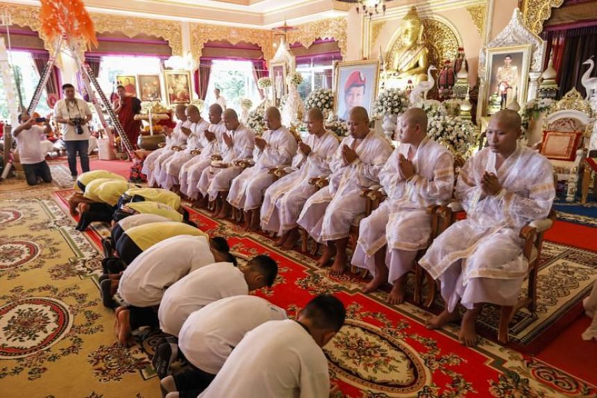 Members of the Wild Boars football team who were rescued from the cave bowing before novice Buddhist monks during a religious ceremony in Chiang Rai on July 19, 2018.