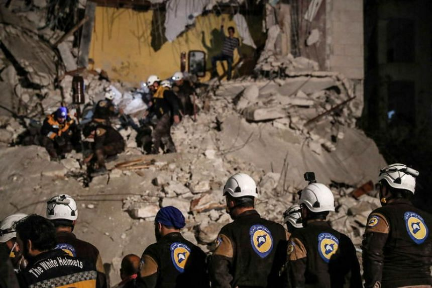 Volunteers with the White Helmets conducting rescue operations in Idlib, Syria, on April 9, 2018. Around 800 members of the White Helmets and their families were evacuated to Jordan via Israel.