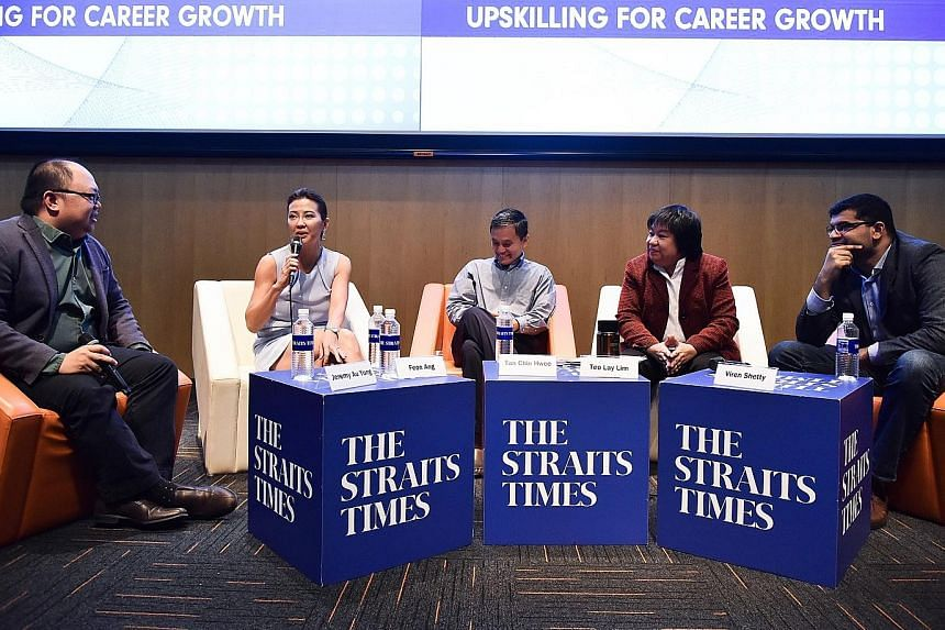 An audience of about 220 heard the panel's thoughts on job trends, as well as values and skills that are increasingly sought-after. They raised a range of questions including what sort of skills are in demand and how to start a company. (From left) M