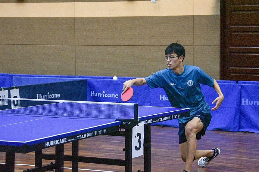 Josh Chua returning a backhand during his 11-9, 11-5, 8-11, 11-6 win over Thailand's Supakron Pankhaoyoy in the final match of the Asean Schools Games boys' table tennis team final in Klang. Both the paddlers and the girls' artistic gymnastics team r