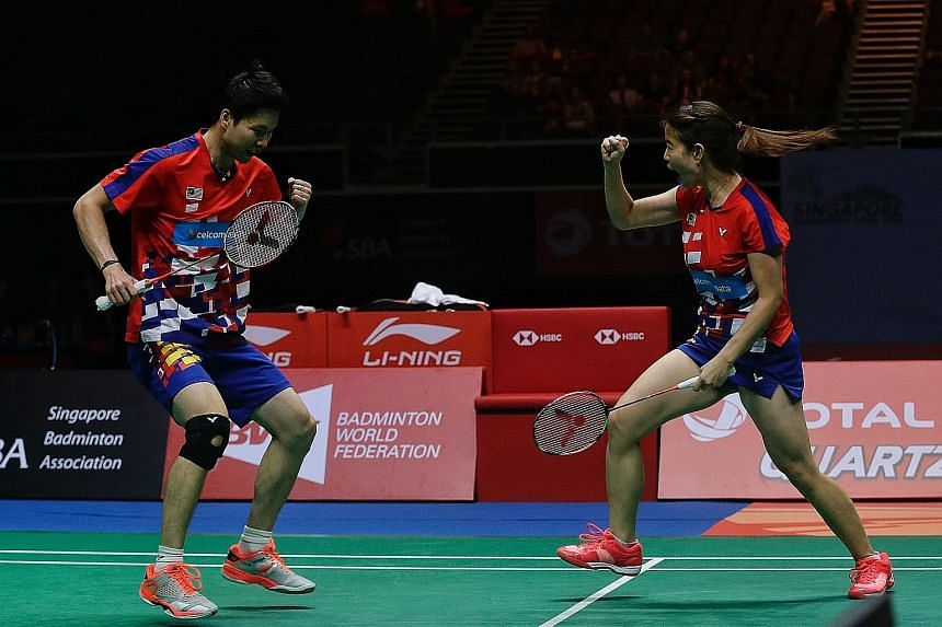 Malaysia's Goh Soon Huat and Shevon Jemie Lai celebrating after taming Olympic champions Liliyana Natsir (above) and Tontowi Ahmad of Indonesia in the Singapore Badminton Open mixed doubles final at the Singapore Indoor Stadium yesterday.