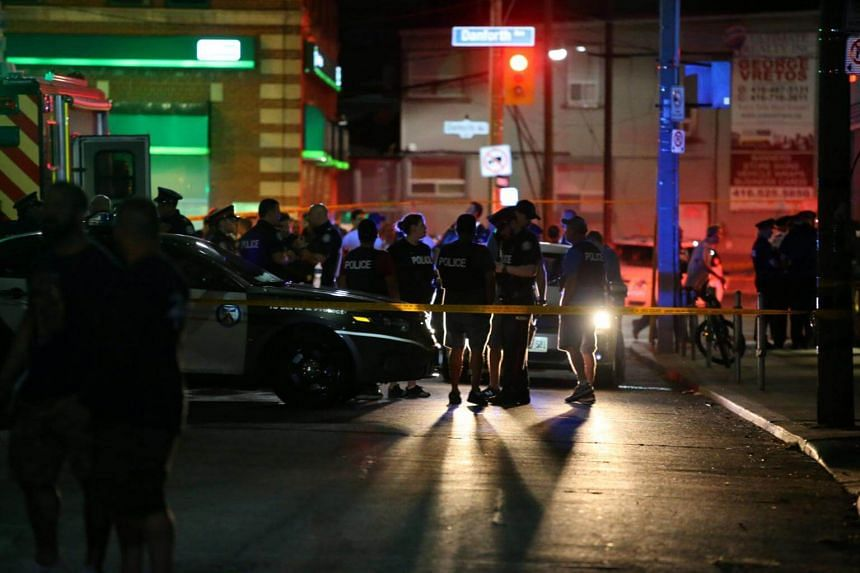 Police near the scene of a mass shooting in Toronto, Canada on July 22, 2018.