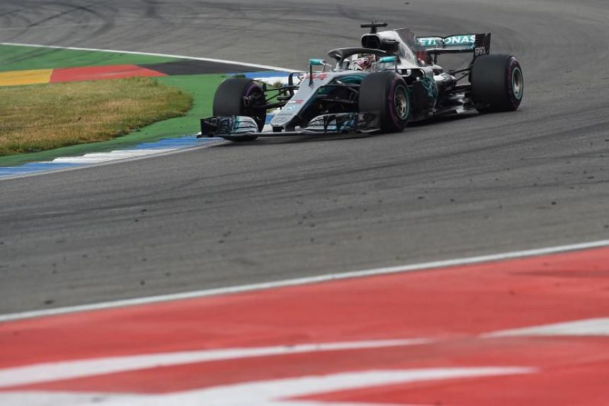Mercedes' British driver Lewis Hamilton steers his car during the German Formula One Grand Prix at the Hockenheim racing circuit in Hockenheim, southern Germany, on July 22, 2018.