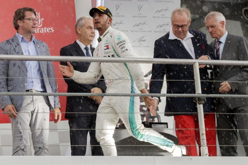 British Formula One driver Lewis Hamilton of Mercedes AMG GP celebrates on the podium after the 2018 Formula One Grand Prix of Germany at the Hockenheimring in Hockenheim, Germany, on July 22, 2018.