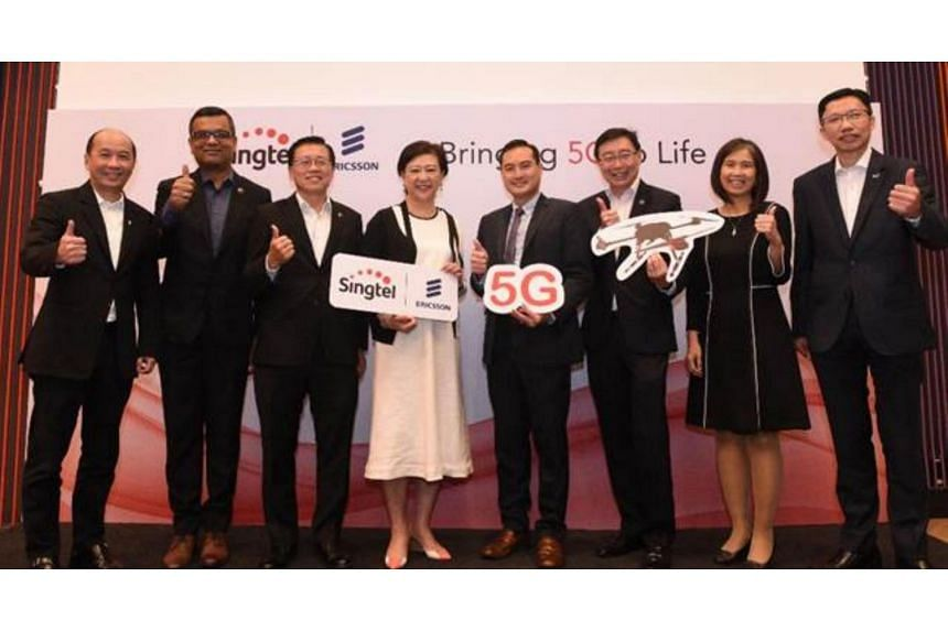 (From left) Consumer Singapore CEO for Singtel Yuen Kuan Moon, Ericsson Head for Network Solutions, Southeast Asia, Oceania & India, Nitin Bansal, Singtel GCTO Mark Chong, Singtel GCEO Chua Sock Koong, IMDA CE Tan Kiat How, Group Enterprise CEO for S