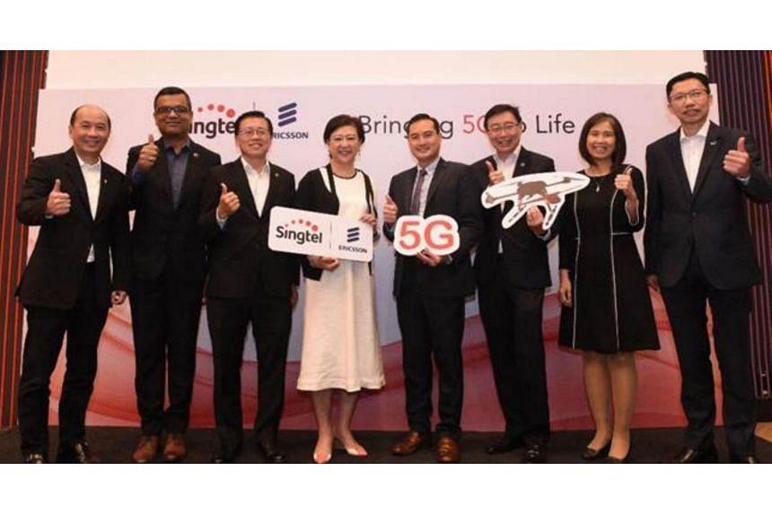 (From left) Consumer Singapore CEO for Singtel Yuen Kuan Moon, Ericsson Head for Network Solutions, Southeast Asia, Oceania & India, Nitin Bansal, Singtel GCTO Mark Chong, Singtel GCEO Chua Sock Koong, IMDA CE Tan Kiat How, Group Enterprise CEO for S