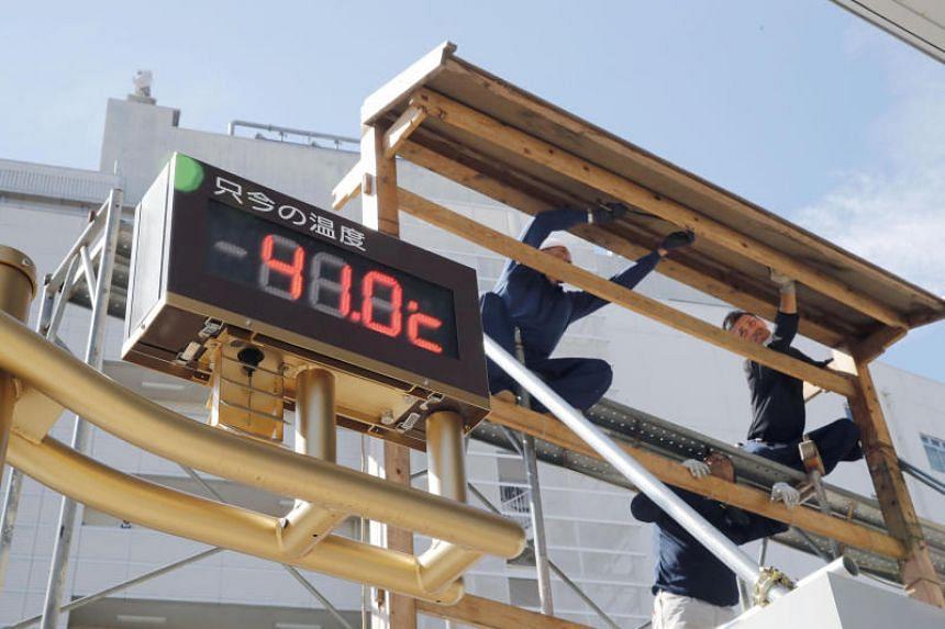 A temperature indicator measures 41.0 deg C in Kumagaya, on July 23, 2018.