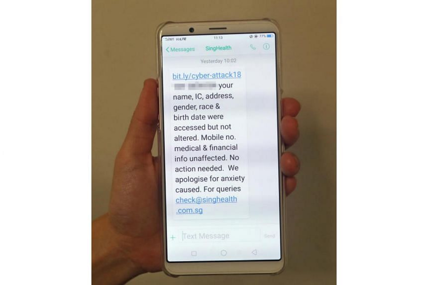 An SMS message sent by SingHealth to clients affected by a cyberattack is seen on a mobile phone.