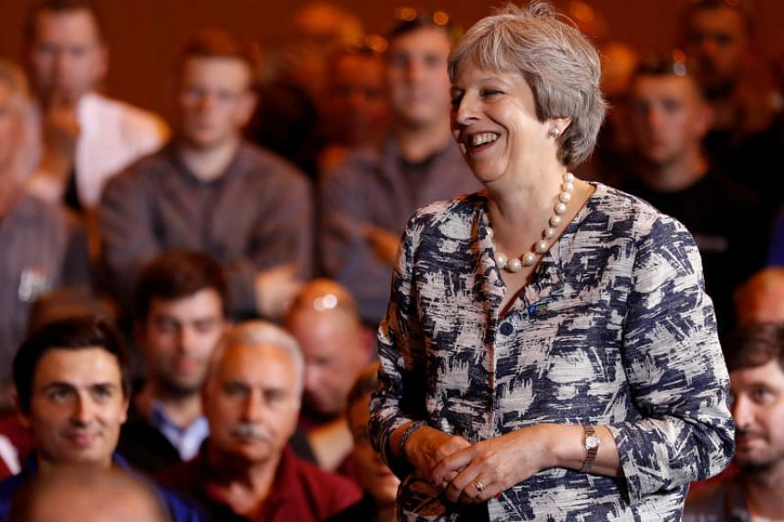 Britain's Prime Minister Theresa May speaks during a question-and-answer session with employees at the Armstrong Works engineering facility in Newcastle on July 23, 2018.