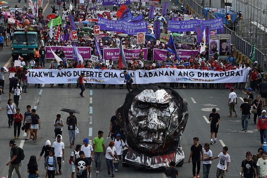 """Protesters in the Philippines marching towards Congress in Manila where President Rodrigo Duterte delivered his state of the nation address yesterday. He said the anti-narcotics campaign, which has earned him international notoriety, was """"far from ov"""