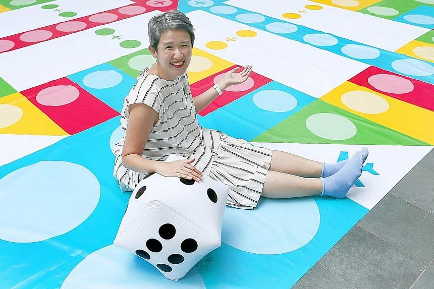 Ms Natalie Tan, senior place-making manager of Aliwal Arts Centre, with the Giant Aeroplane Game at Aliwal Street carpark.