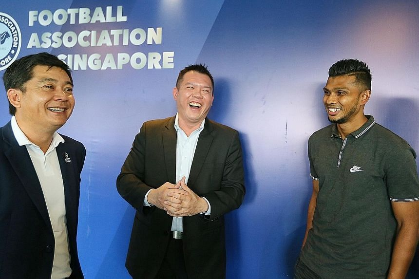 From left: FAS deputy president Bernard Tan, PSB Academy CEO Derrick Chang, and Hougang United striker Fazrul Nawaz, the first beneficiary of the tie-up.