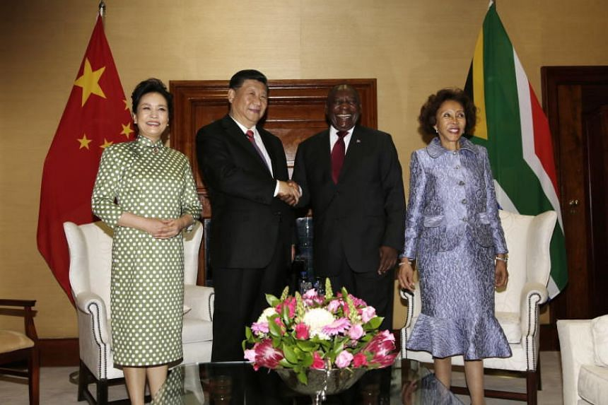 China's President Xi Jinping shakes hands with South Africa's President Cyril Ramaphosa during Mr Xi's state visit to Pretoria on July 24, 2018.
