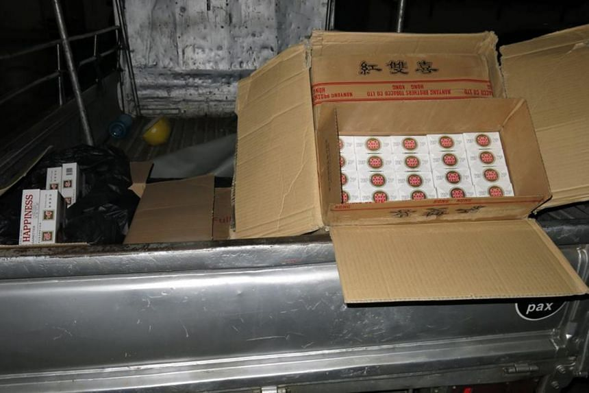 Authorities arrested two men and seized more than 1,600 cartons of contraband cigarettes in an operation on July 18, 2018.