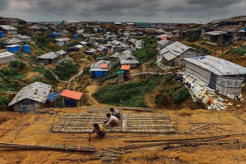 Rohingya refugees use bamboo to build a shelter at Balukhali refugee camp in Ukhia, Bangladesh, on July 21, 2018.