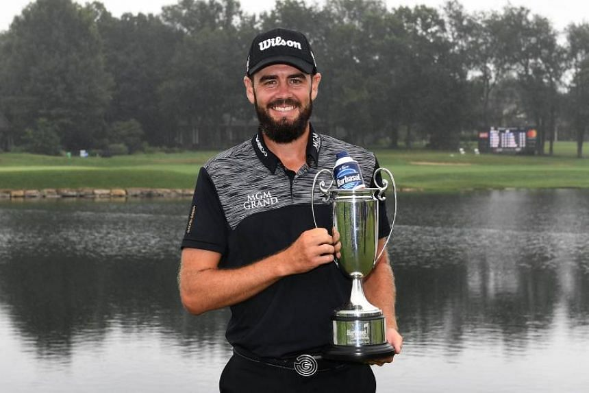Troy Merritt poses with his trophy after winning the Barbasol Championship in Lexington, Kentucky, on July 23, 2018.