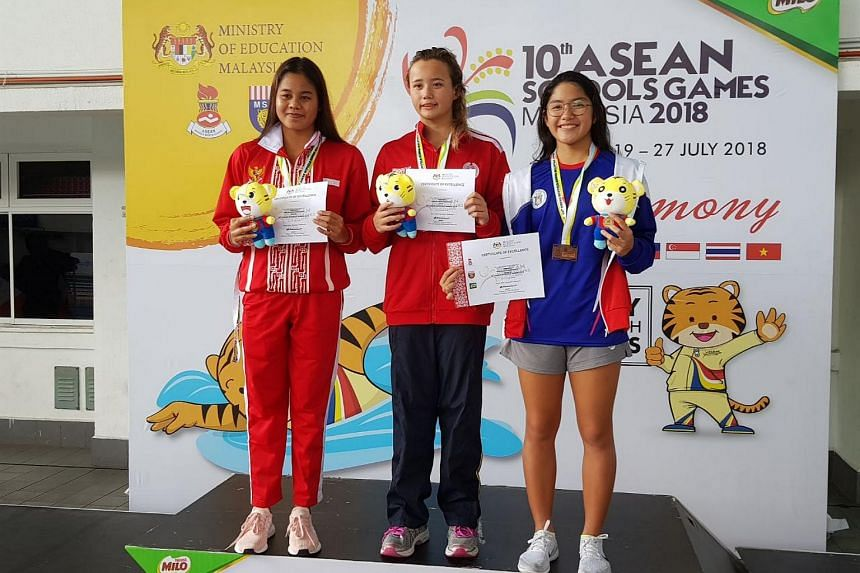 Singapore's Elena Pedersen (centre) posing on the podium with Indonesia's Lestari Dewi Novita (left) and Samantha Coronel of the Philippines after she won the 100m backstroke gold at the Asean Schools Games on July 24, 2018.