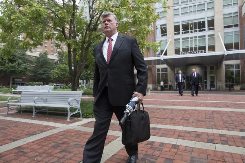 Kevin Downing, attorney representing former Trump campaign chairman Paul Manafort, arrives outside the US District Court for a pre-trial hearing in Alexandria, Virginia, US, on July 23, 2018.