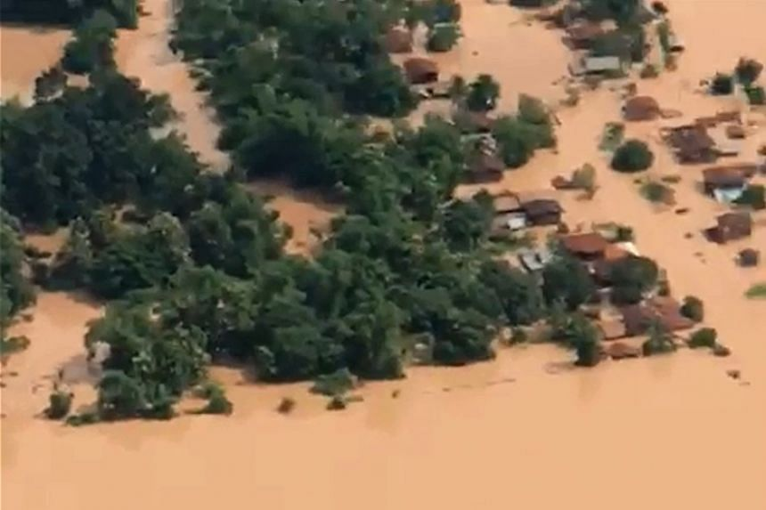 An aerial view of the flooded plains in Attapeu province after a dam collapsed the day before.