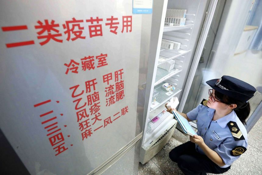 A local market supervisory authority official checking on vaccines. Changchun Changsheng Biotechnology Co and its parent company, Changsheng Biotech, are found to be involved in at least 10 bribery-related cases in the past decade.