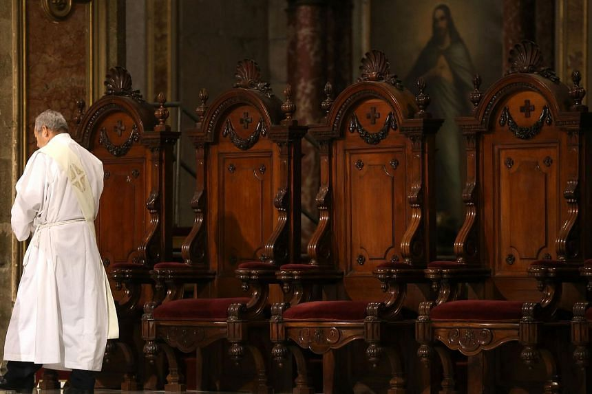 File photo showing a priest during a mass celebration at a cathedral in Santiago, Chile, on May 18, 2018.