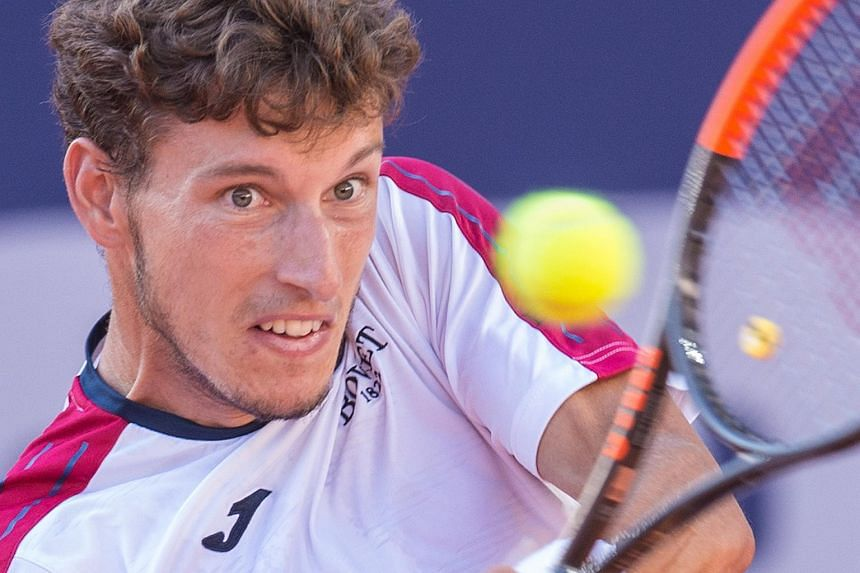 Spain's Pablo Carreno Busta returning the ball to Germany's Florian Mayer during their tennis match at the German ATP Tennis Championships, on July 23, 2018.