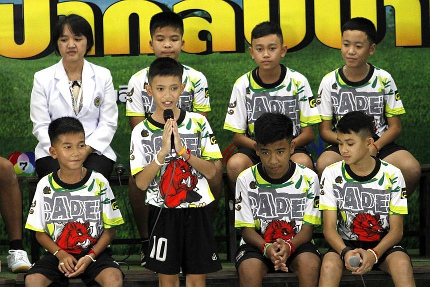 Members of the Wild Boar football team speaks to a journalist during a broadcast program in Chiang Rai province, Thailand, on July 18, 2018.
