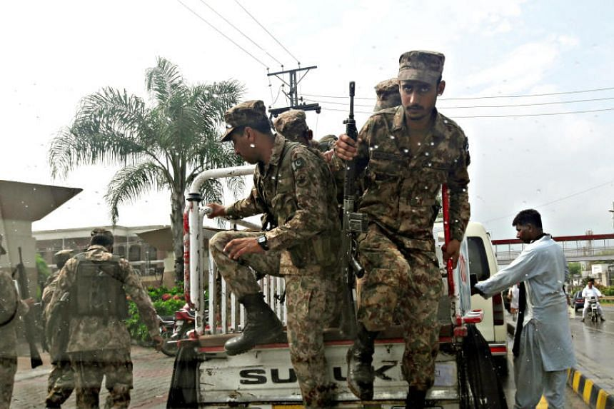Soldiers arrive to guard at the judicial complex where election material will be distributed ahead of general election in Rawalpindi, Pakistan, on July 24, 2018.