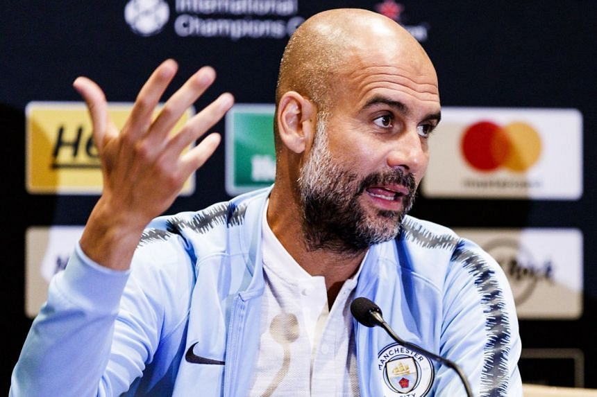 Pep Guardiola speaking to reporters in New York.
