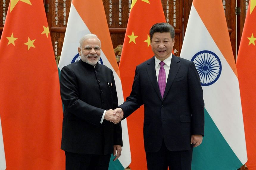 Indian Prime Minister Narendra Modi (left) shaking hands with Chinese President Xi Jinping before a summit in Hangzhou, Zhejiang province, China, on Sept 4, 2016.