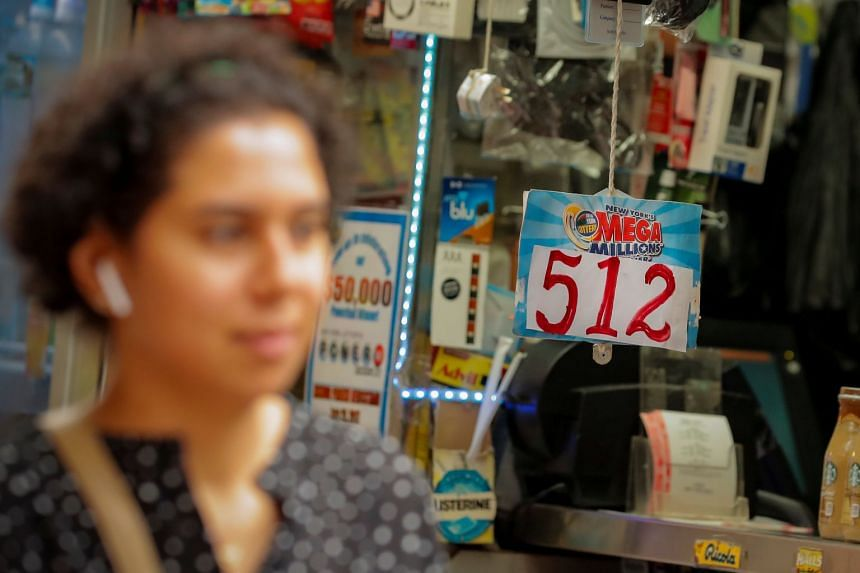 A sign displays that the Mega Millions Lottery prize is US$512 million at a newsstand in New York City.