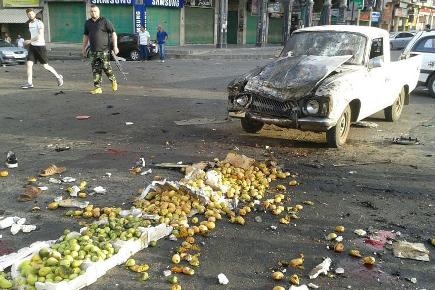 Damage after a suicide bomb attack is seen in Sweida, Syria.